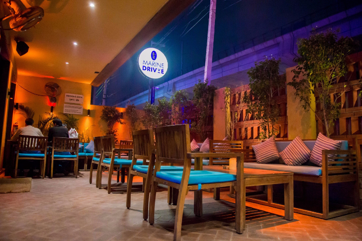 marine drivve club courtyard outdoor seating rajouri garden